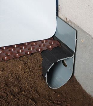 Closeup of a crawl space drainage system installed in North Chili