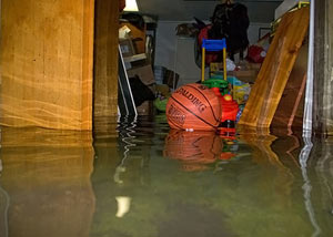 A flooded basement bedroom in North Chili
