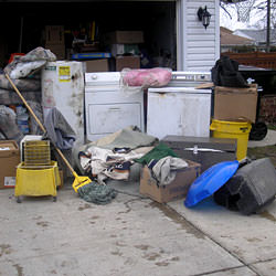 Soaked, wet personal items sitting in a driveway, including a washer and dryer in Canandaigua.